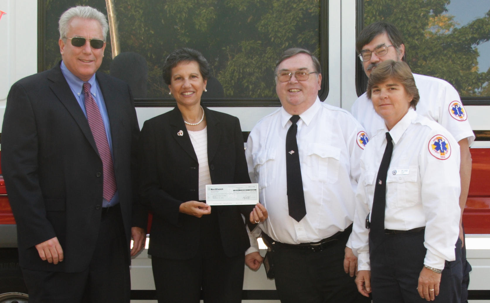 Robert Krukowski, Director Hopewell Facilities and Helene Garcia, Director      Community & Strategic Initiatives present check to President Daniel Boone,      Captain Cindy Orlandi, and First Assistant Captain Kirk Schmitt