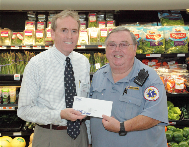 PQM Owner and Manager, Michael Rothwell, presents PFAS President Daniel Boone with a check for funds raised and matched by PQM during the PQM 55<sup>th</sup> birthday party.