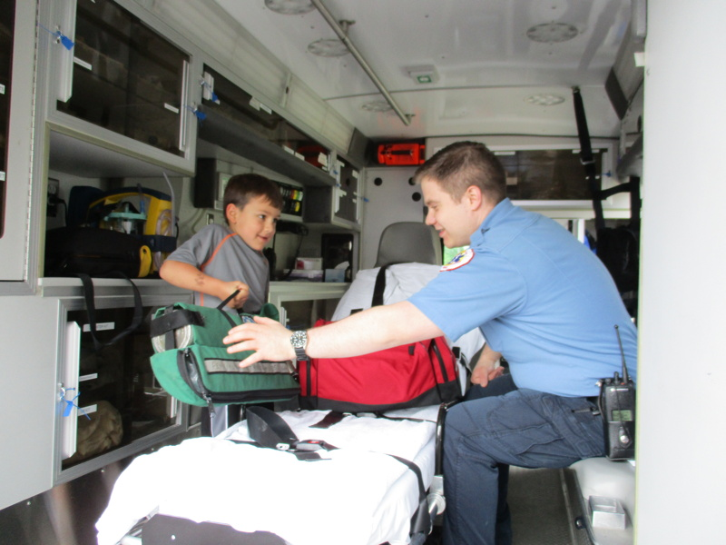 Assistant Captain John Muccioli shows ambulance and equipment.